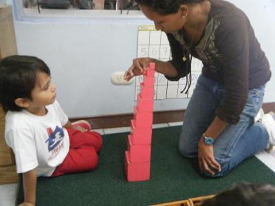 Brenda working with one of the children in the school