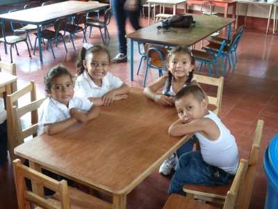 Children in one of the Montessori schools in Puerto Morazán with their new tables and chairs which were made locally and financed by a generous donor in England